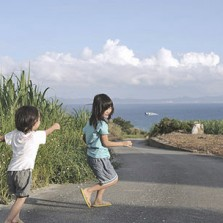Kids playin on a country road